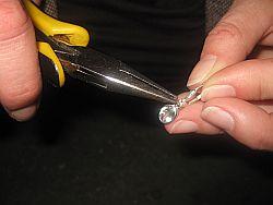 Aquamarin-Ohrhänger bekommt Clip-Brisur